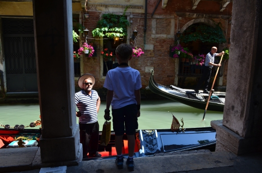 A young boy inquires about the price of a gondola ride.