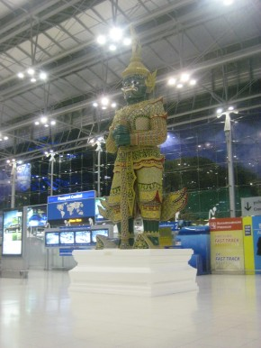 A giant god welcoming you to the grandeur of Bangkok's airport.