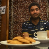 Having Indian chai and cookies with Sahil at his textiles/gifts store.