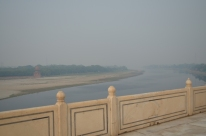 A thick haze from burning trash enveloped the Taj and the river Yamuna.