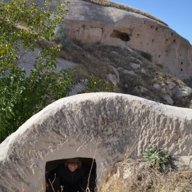 Investigating one of the many cave formations in Cappadocia. Apparently people were a bit smaller back then...
