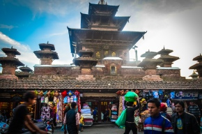 Passersby in front of a textile store outside of Durbar square.