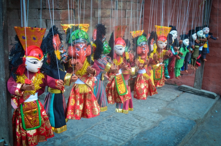 Handmade dolls watching over the scene in Durbar Square.
